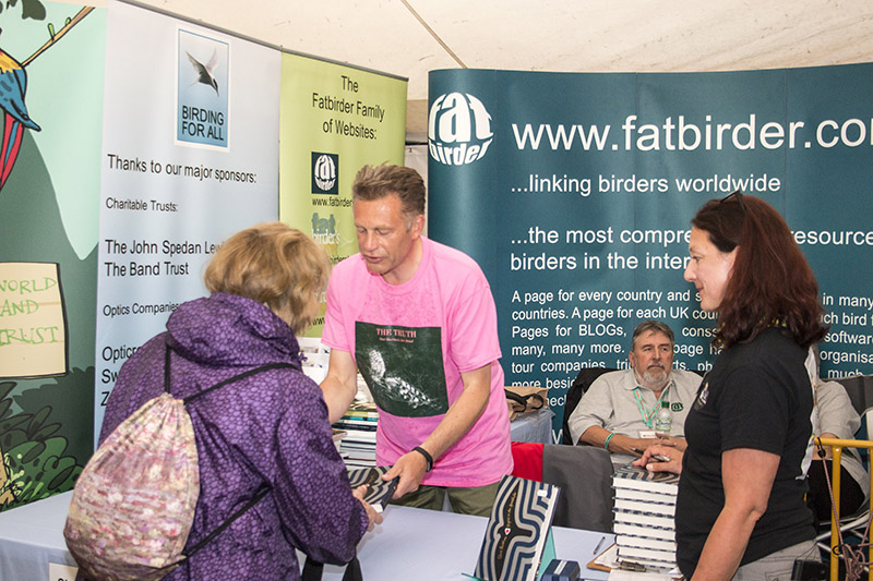 "Chris Packham signing his book ""Fingers in the Sparkle Jar"" on the Birding For All stand 2016 birdfair"